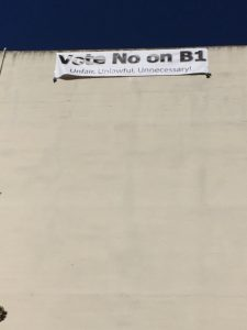 No on B1 banner on Oak Street building.